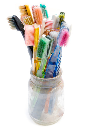outworn: Old toothbrushes used for creative artwork. Isolated on a white background.
