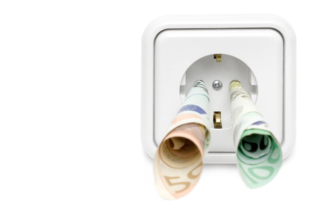 Banknotes attached to a power socket. Isolated on a white background. photo
