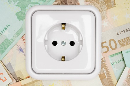 takings: Power socket isolated on a money background. Stock Photo