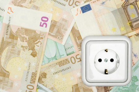 takings: Money background and power socket.