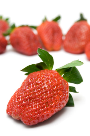 foodstill: Bunch of Strawberries. Front one focused. Isolated on a white background. Stock Photo