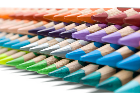 Colored pencils isolated on a white background. Shallow depth of field. photo