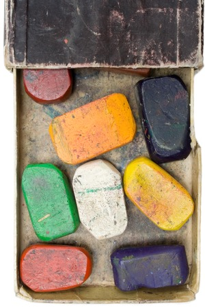 utilized: Colorful wax crayons in an old box. Isolated on a white background. Stock Photo