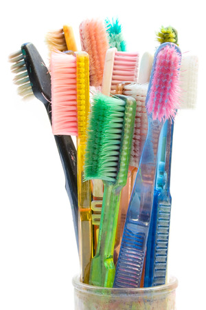 Old toothbrushes used for creative artwork. Isolated on a white background.