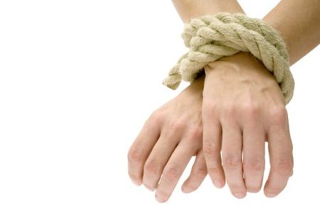 handcuffed: Handen en voeten gebonden. Geïsoleerd op een witte achtergrond.