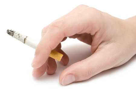 Female hand holding a cigarette. Isolated on a white background.