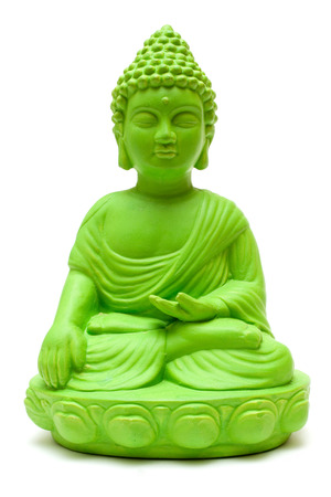 Green Buddha statue isolated on a white background. Stock Photo