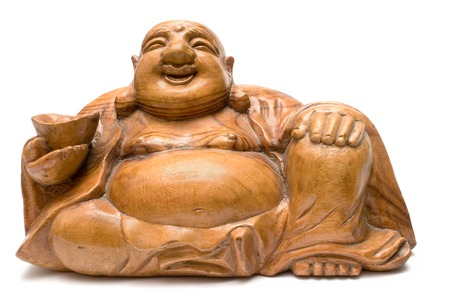 Fat wooden buddha statue isolated on a white background. Manufactured at the beginning of the 20th century. photo