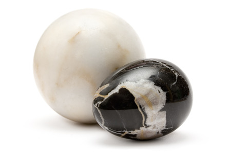 buffed: Black and white marble ball isolated on a white background.