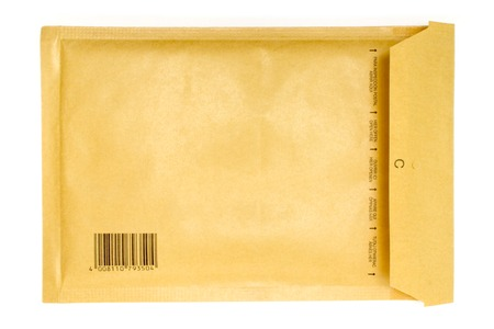 Back view of a brown air-cushioned envelope with an imprinted bar code. Isolated on a white background. photo