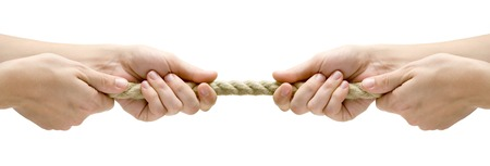 against the war: Rope pulling. Isolated on a white background. Stock Photo