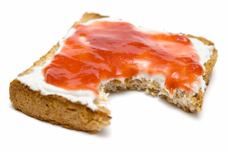 nip: Eating a toast with butter and jam. Isolated on a white background. Stock Photo
