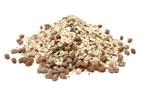 Pile of healthy muesli isolated on a white background. photo