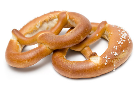 Salted pretzels isolated on a white background.