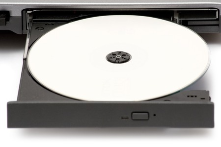 Blank CD in a notebook drive. White background.