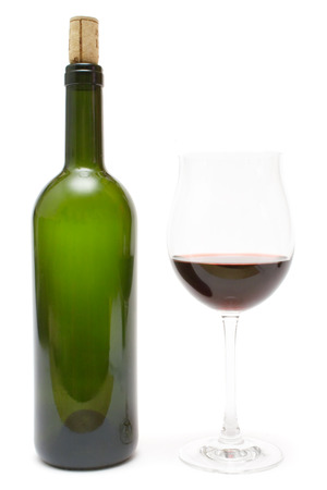 poured: Wine bottle and a glass of red wine isolated on a white background.
