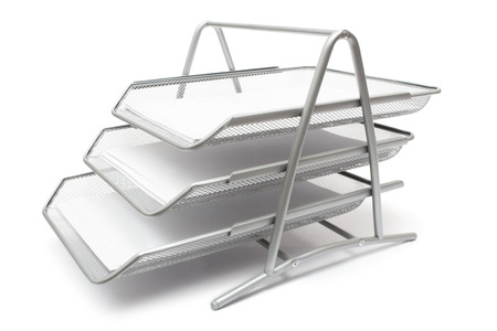 Metal filing baskets isolated on a white background.