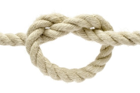 bonding rope: Twisted rope isolated on a white background.