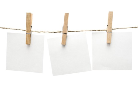 doings: Three notes hanging on a clothesline. Isolated on a white background.