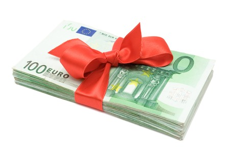 Red ribbon on one hundred Euro banknotes. Isolated on a white background.