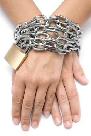 chainlinks: Female hands locked with a metal chain and padlock. Isolated on a white background.