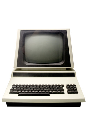 computer control: Retro computer isolated on a white background. Stock Photo