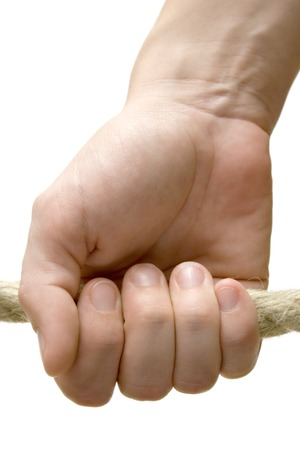 grab: Female hand holding a rope. Isolated on a white background.