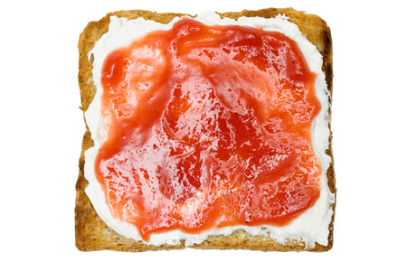 Raspberry jam on a slice of bread. Isolated on a white background.