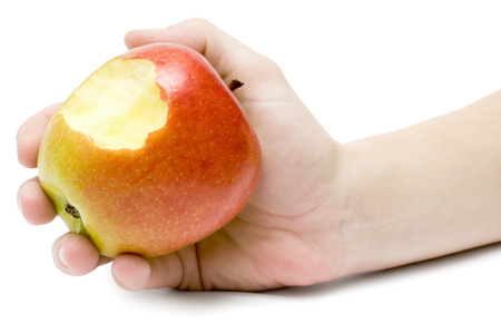 Female hand holding a delicious colorful apple. Isolated on a white background. photo