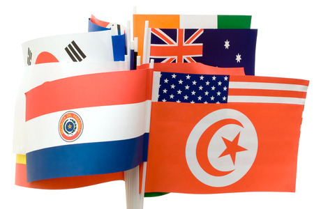 Small paper flags of various nations isolated on a white background. Stock Photo - 1478178