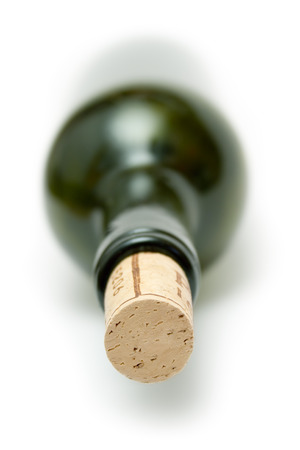 closed corks: Lying wine botte. Shallow depth of field. Isolated on a white background.