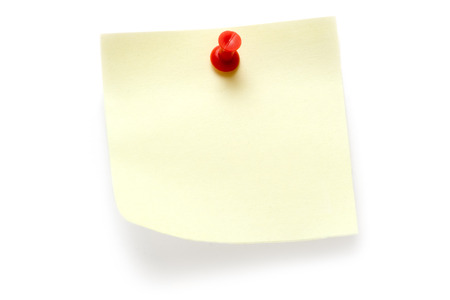 Yellow note attached with a red pin. Isolated on a white background. photo