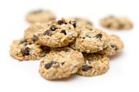 roughage: Bunch of cookies isolated on a white background. Shallow depth of field.