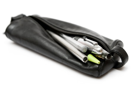 Writing utensils in a black leather pouch. Isolated on a white background. Stock Photo - 1478215