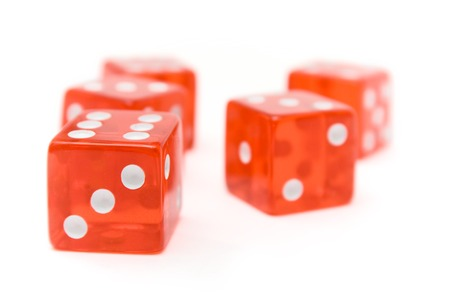Translucent red dice isolated on a white background. Shallow depth of field. photo