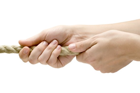 Female hands pulling a rope. Isolated on a white background.