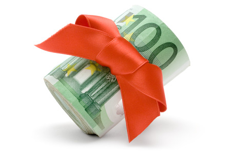 One hundred Euro banknotes with a red ribbon isolated on a white background. Stock Photo - 1545991