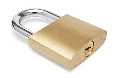 fastening objects: Lying padlock isolated on a white background. Stock Photo