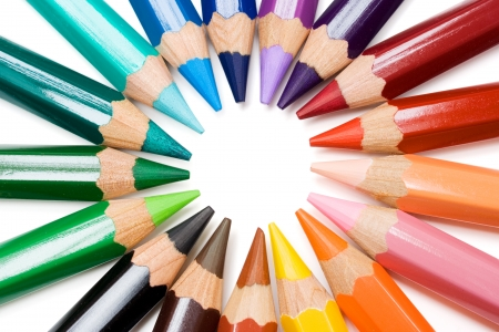 primary colours: Colored pencils forming a color circle. White background.
