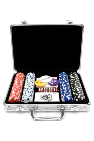 Poker cards, chips and dice in a metal case. Isolated on a white background.
