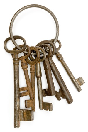tarnish: Antique bunch of keys isolated on a white background. Stock Photo