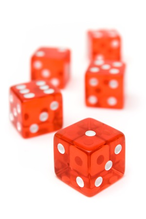 Translucent dice isolated on a white background. Shallow depth of field. Stock Photo