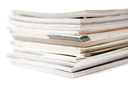 Close-up on a bunch of magazines. White background.
