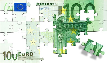 one hundred euro banknote: Jigsaw pieces forming a green one hundred Euro banknote. Isolated on a white background.
