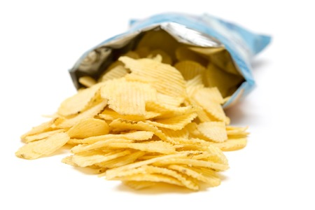 crisps: Bag of golden chips isolated on a white background. Stock Photo
