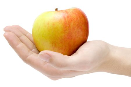 Female hand presenting a colorful apple. Isolated on a white background. photo
