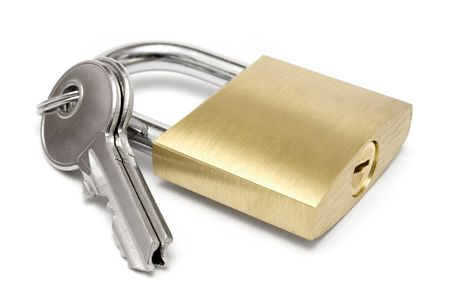 Two keys attached to a golden padlock. Isolated on a white background. photo