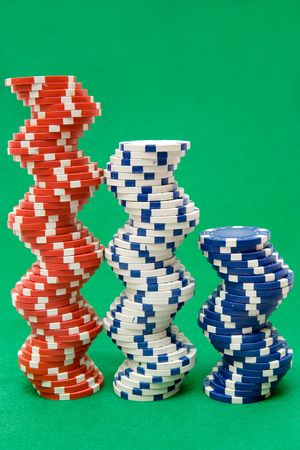 Stacked jetons isolated on green poker table felt. photo