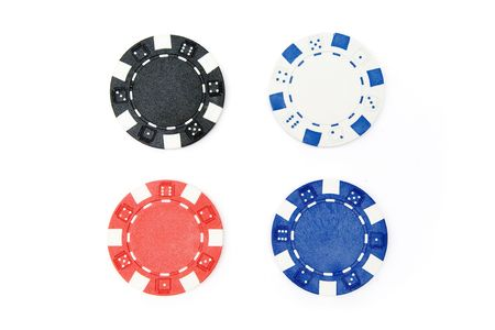 Different poker chips isolated on a white background. photo
