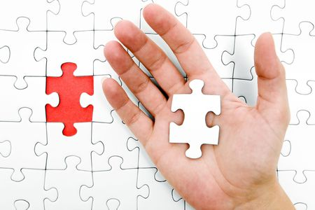 missing link: Open hand with the missing puzzle piece.